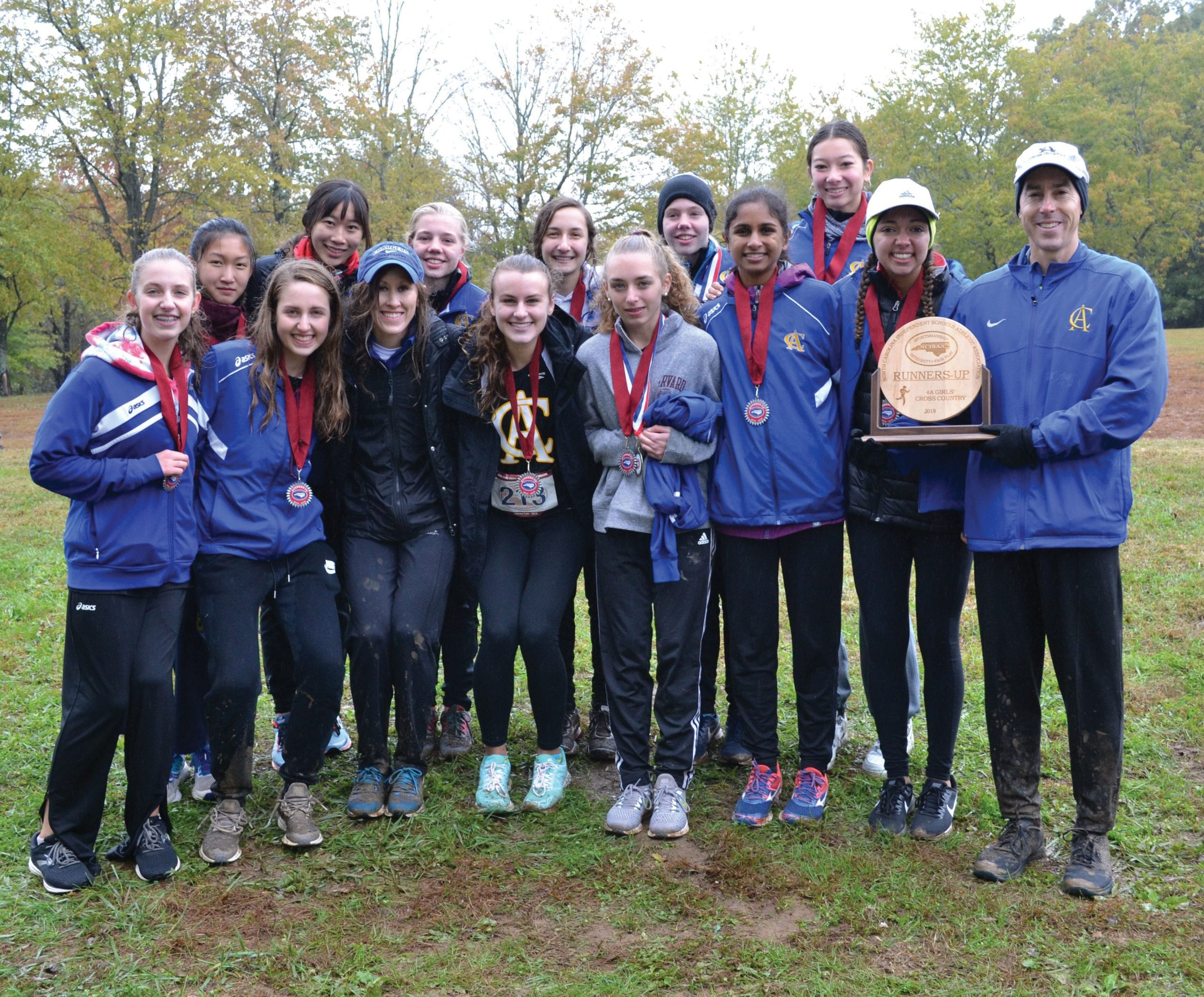 Conrad Hall and girls cross country team