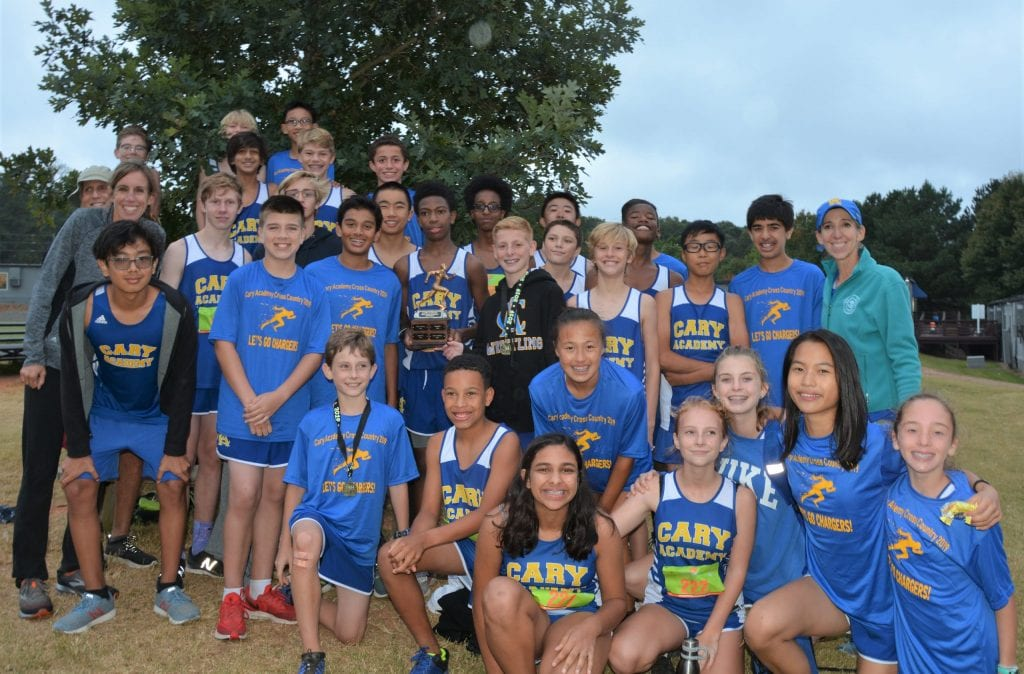 Middle School cross country team with trophy
