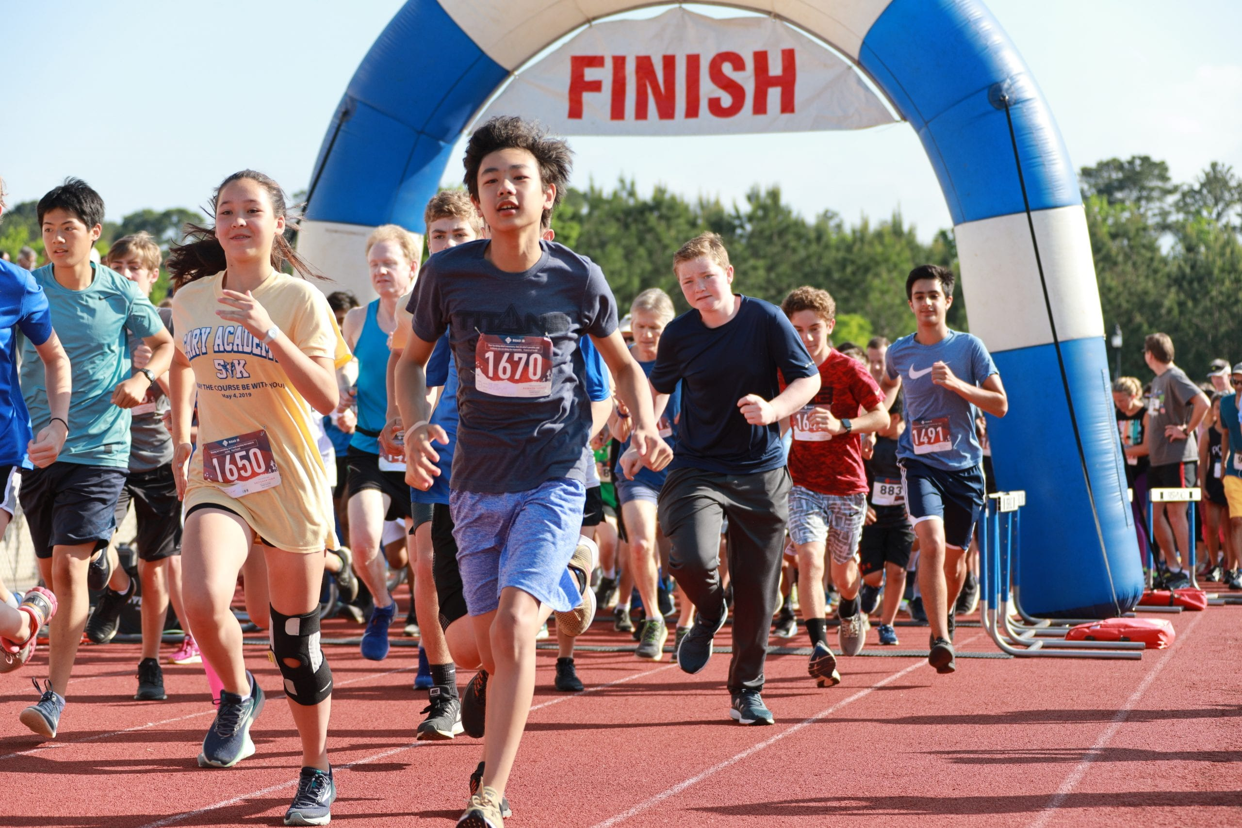 Cary Academy 5K run - students at the start finish line