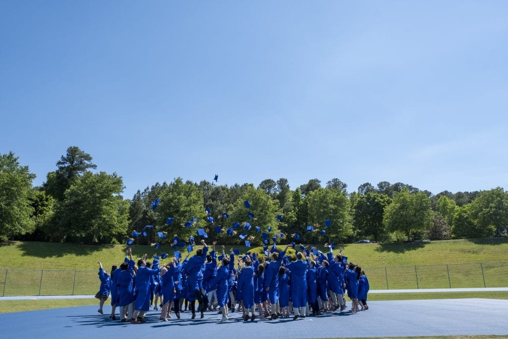 Class of 2021 tosses their caps in the air