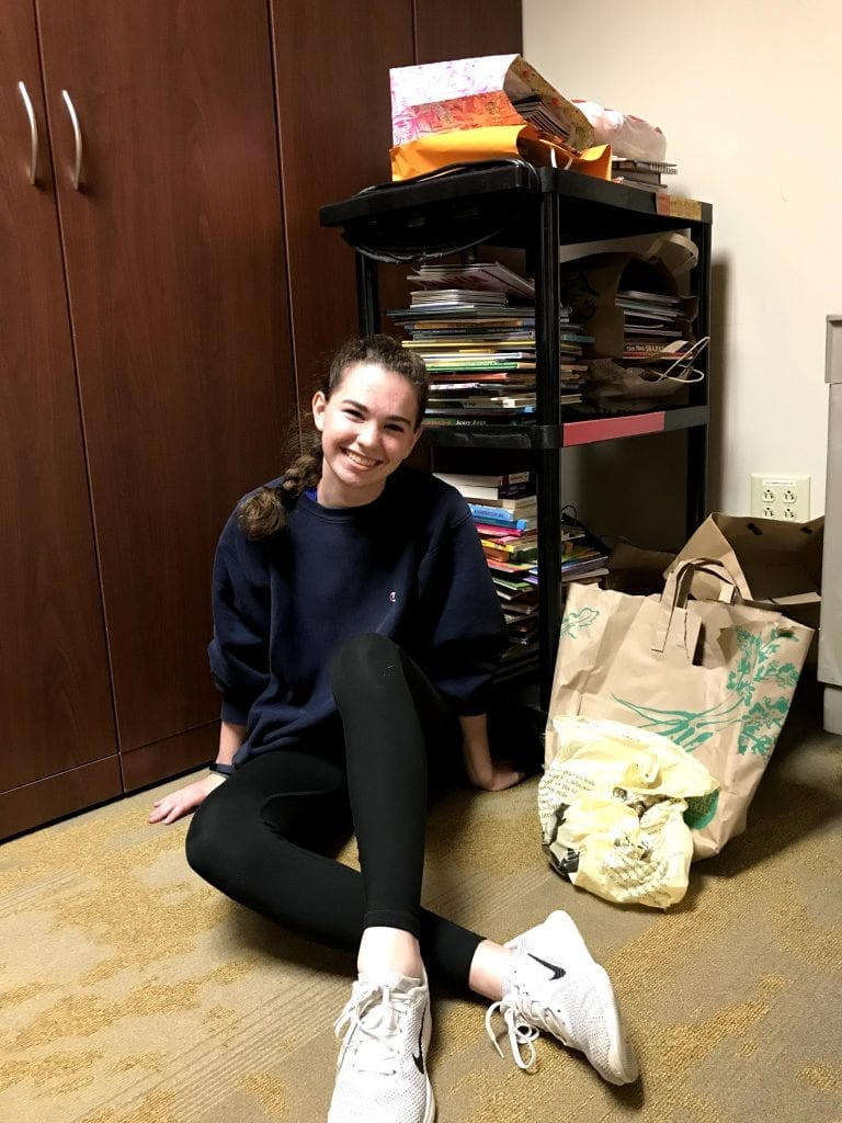 Ellie McMahon '21 with books during the book drive