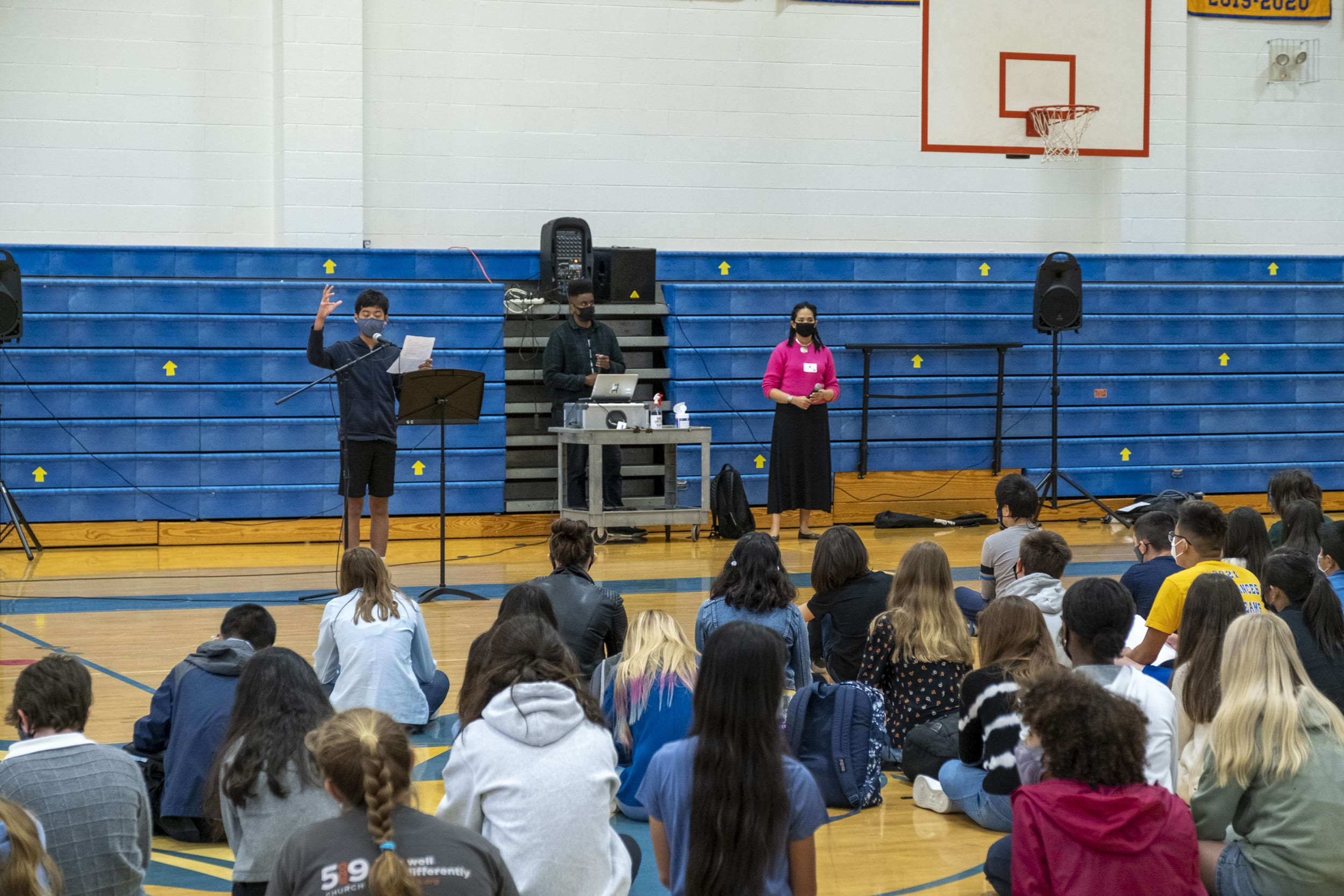 A student reads a poem at the Poetry Slam