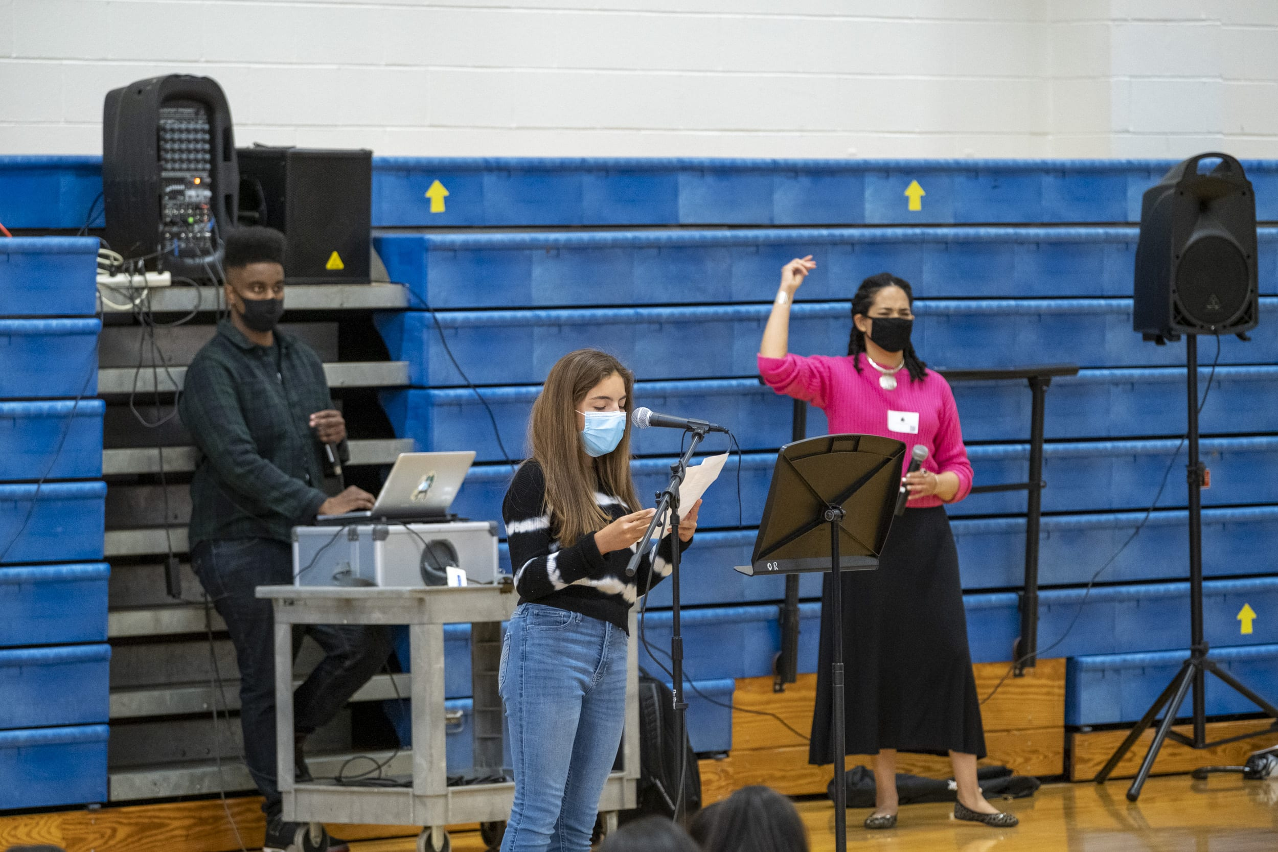 A student sings an original song at the Poetry Slam
