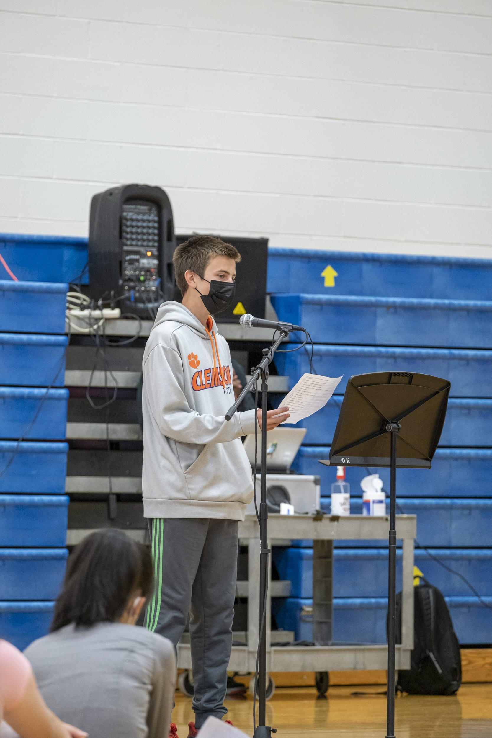 A student reads his poem at the Poetry Slam