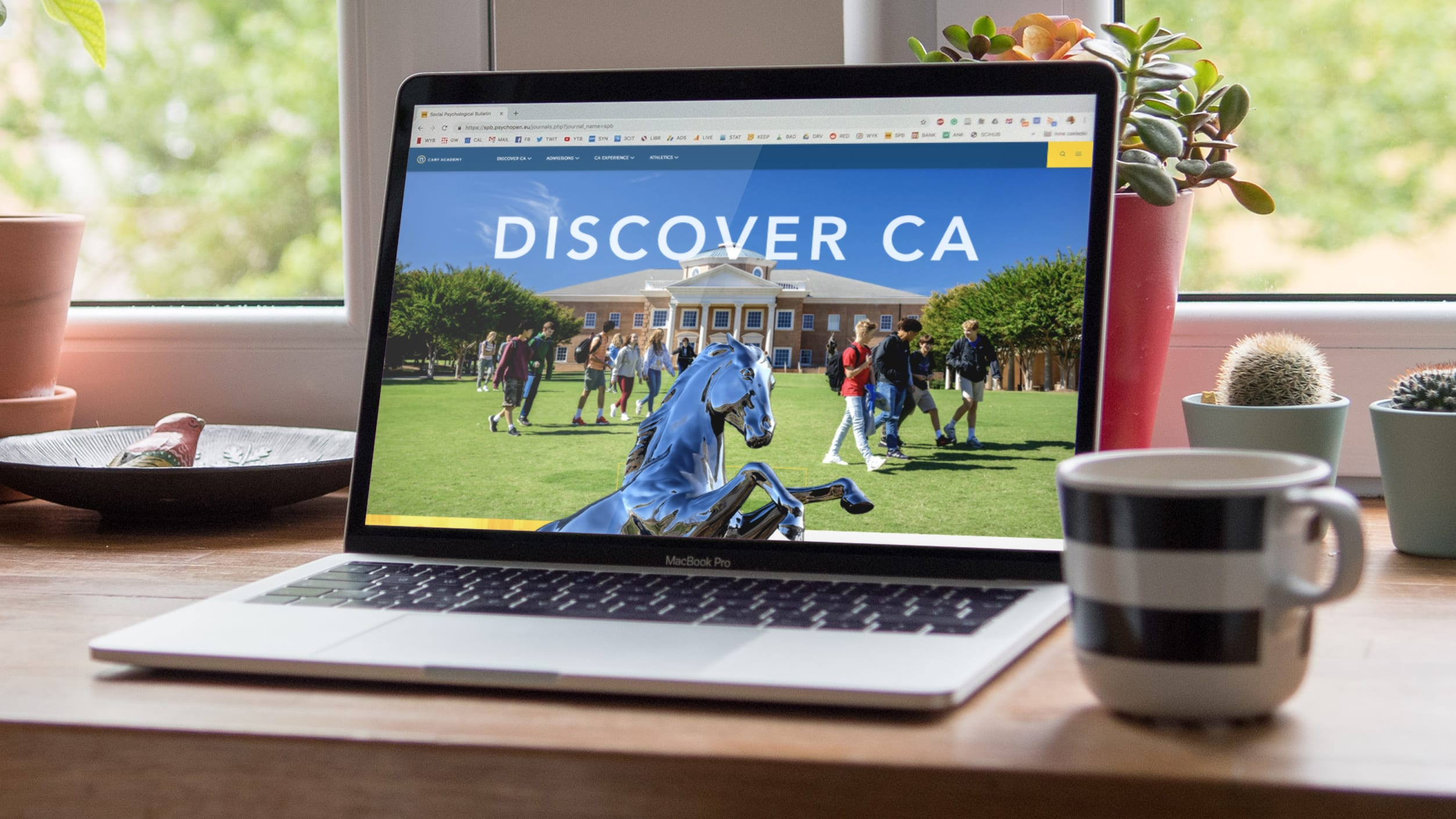 Cary Academy homepage on a laptop